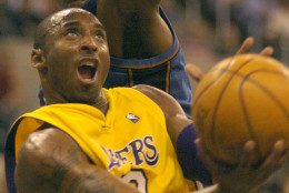 Los Angeles Lakers guard Kobe Bryant shoots past Washington Wizards center Brendan Haywood during a preseason game Thursday, Oct. 28, 2004, in Oklahoma City. (AP Photo/ Jeffrey Haderthauer)