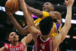Los Angeles Lakers' Kobe Bryant puts up a shot as Houston Rockets' Yao Ming and Jon Barry guard during the second half Friday night, Jan. 7, 2004, in Los Angeles. (AP Photo/Mark J. Terrill)
