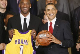President Barack Obama stands with Los Angeles Lakers guard Kobe Bryant, in the East Room of the White House in Washington, Monday, Jan. 25, 2010, during a ceremony honoring the 2009 NBA basketball champions Los Angeles Lakers. (AP Photo/Charles Dharapak)