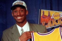 FILE - In this July 12, 1996, file photo, Kobe Bryant, 17, jokes with the media as he holds his Los Angeles Lakers jersey during a news conference in Inglewood, Calif. Bryant was acquired from the Charlotte Hornets by the Lakers in exchange for veteran center Vlade Divac. This was a key moment in the life of a five-time champion and 18-time All-Star. (AP Photo/Susan Sterner, STf)