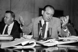 """Sen. Joseph McCarthy, R-Wis., gives a resigned shrug at being unable to get across with one of his """"point of order"""" interruptions, during the Senate Investigation Subcommittee hearing, in Washington, D.C., April 30, 1954. Pvt. G. David Schine was in the witness chair at the time. (AP Photo/WF)"""
