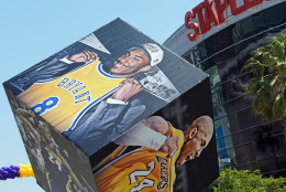 Giant displays commemorating Kobe Bryant's career have been added outside Staples Center before his last NBA basketball game, a contest against the Utah Jazz, in downtown Los Angeles Wednesday, April 13, 2016.  Many of Bryant's fans - even some of the adults - have never known Los Angeles without him. I's a feeling they're about to have to get used to as fans celebrate his final night as a Laker. (AP Photo/Richard Vogel)