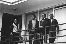 FILE - In this April 3, 1968 file photo, the Rev. Martin Luther King Jr. stands with other civil rights leaders on the balcony of the Lorraine Motel in Memphis, Tenn., a day before he was assassinated at approximately the same place. From left are Hosea Williams, Jesse Jackson, King, and Ralph Abernathy. King is one of America's most famous victims of gun violence. Just as guns were a complicated issue for King in his lifetime, they loom large over the 30th anniversary of the holiday honoring his birthday. (AP Photo, File)