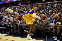 Los Angeles Lakers guard Kobe Bryant (24) balances on one foot as he saves the ball from going out of bounds in the second half of an NBA basketball game against the Washington Wizards, Wednesday, Dec. 3, 2014, in Washington. The Wizards won 111-95. (AP Photo/Alex Brandon)