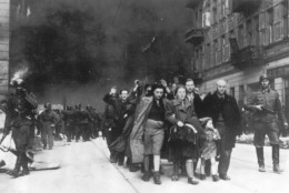 ** FILE ** In this 1943 file photo, a group of Polish Jews are led away for deportation by German SS soldiers, in April/May 1943, during the destruction of the Warsaw Ghetto by German troops after an uprising in the Jewish quarter. The family of Polish social worker Irena Sendler who is credited with rescuing 2,500 Jewish children from the Nazis during the Holocaust says she has died. Sendler's daughter, Janina Zgrzembska, says her 98-year-old mother died Monday, May 12, 2008, morning in a Warsaw hospital. Sendler organized the rescue of Jewish children from the Warsaw Ghetto during Nazi Germany's brutal World War II occupation. (AP Photo)