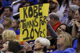 A Kobe Bryant fan holds a sign thanking him for his 20 years during the first half of an NBA basketball game in Oklahoma City, Monday, April 11, 2016. (AP Photo/Alonzo Adams)