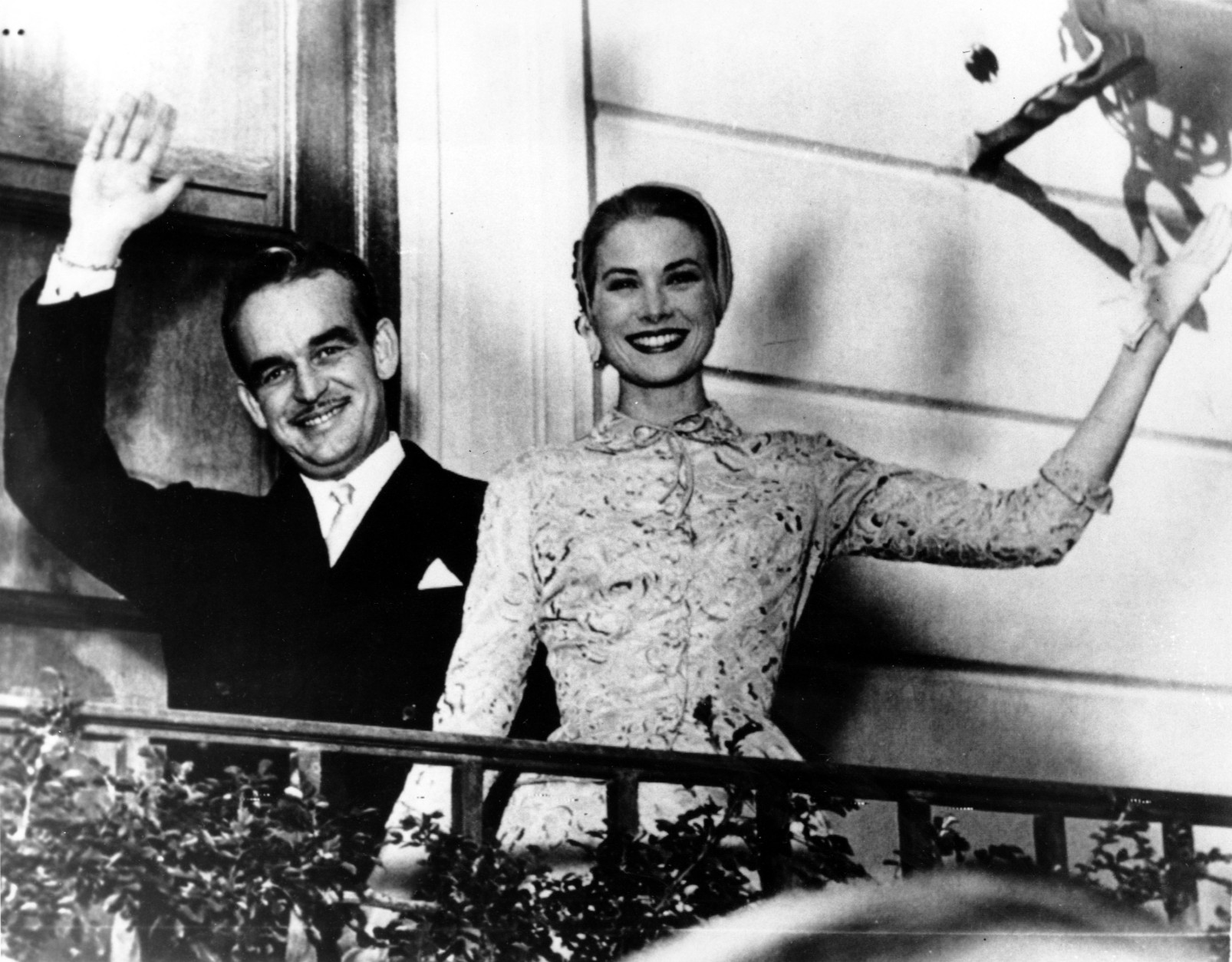Prince Rainier III and actress Princess Grace Kelly wave from the palace terrace at Monaco in the South of France on April 18, 1956. The couple is hosting a garden party for the people of Monaco on the palace grounds after being married in a civil ceremony at the palace a few hours earlier. (AP Photo)