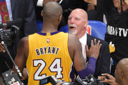 Los Angeles Lakers forward Kobe Bryant, left, and trainer Gary Vitti congratulate each other after an NBA basketball game against the Utah Jazz, Wednesday, April 13, 2016, in Los Angeles. (AP Photo/Mark J. Terrill)