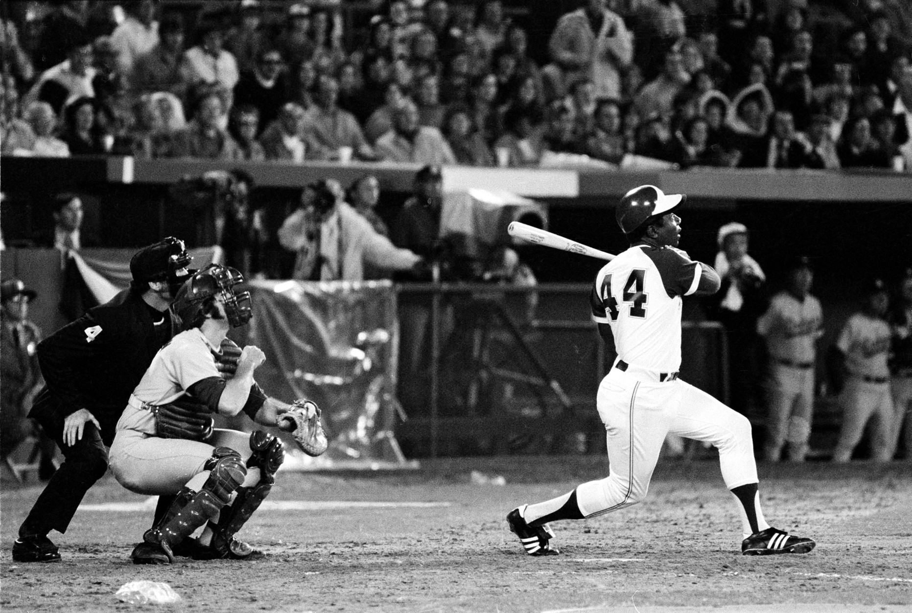 Atlanta Braves' Hank Aaron (44) breaks Babe Ruth's record for career home runs as he hits his 715th off Los Angeles Dodgers pitcher Al Downing in the fourth inning of the game opener at Atlanta-Fulton County Stadium, Ga., Monday night, April 8, 1974.  (AP Photo)