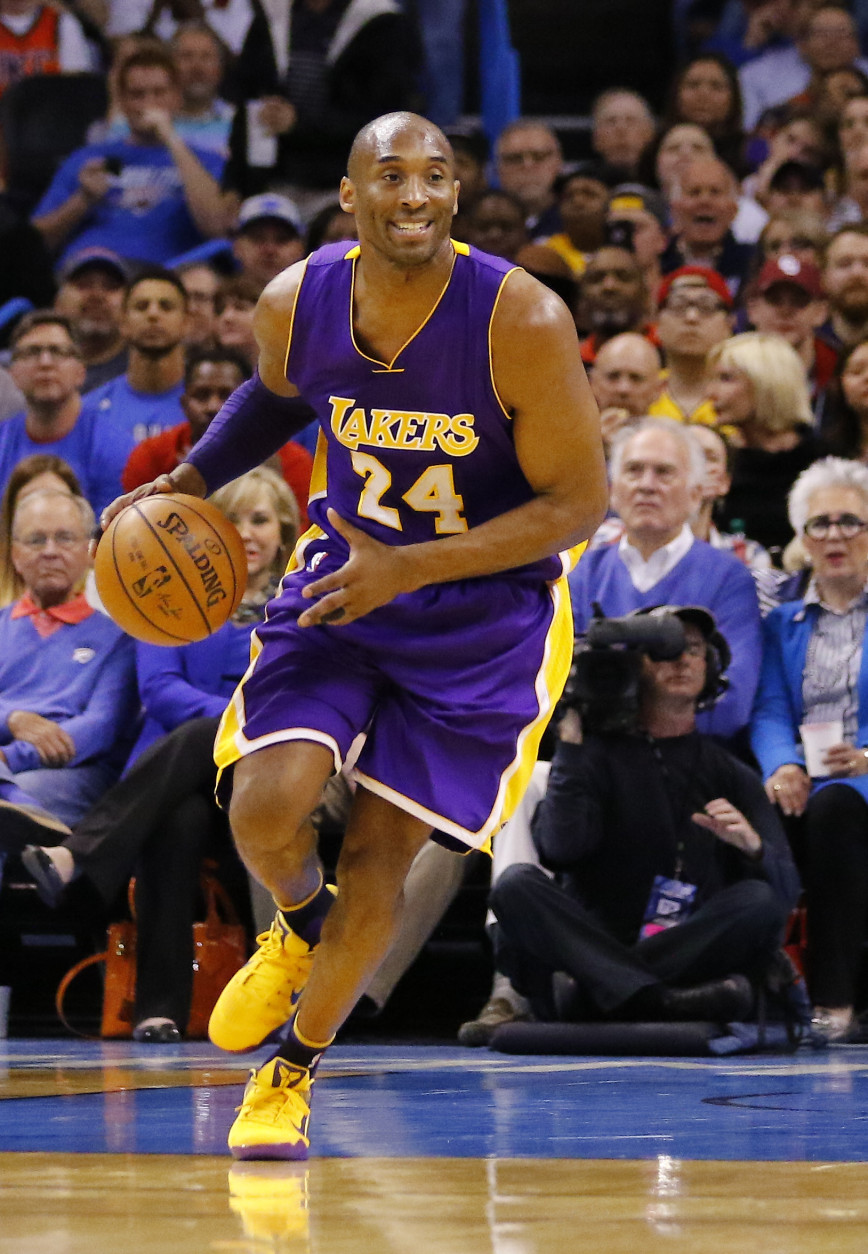 Los Angeles Lakers forward Kobe Bryant (24) drives down the court against the Oklahoma City Thunder during the first half of an NBA basketball game in Oklahoma City, Monday, April 11, 2016. (AP Photo/Alonzo Adams)