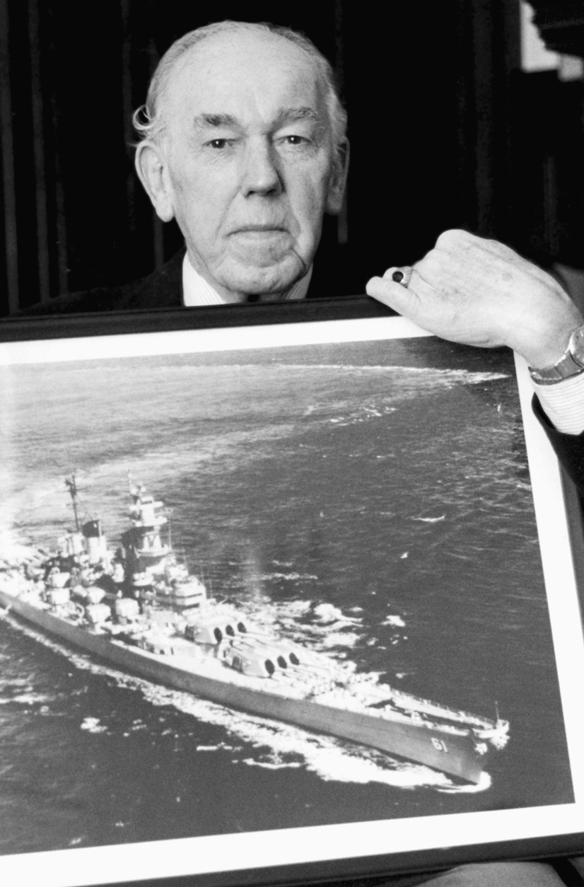 Retired Rear Adm. Julian Becton holds a picture of the USS Iowa Thursday, April 20, 1989 at his Wynnewood, Pa., home.  A former Captain of the battleship, Becton said he believes the explosion which killed 47 sailors could have been caused by burning powder which had not been cleared from a gun barrel. (AP Photo/Bill Cramer)