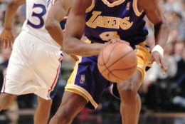 Los Angeles Lakers Kobe Bryant, right, moves past Philadelphia 76ers Allen Iverson during the first half of their game, Tuesday, Nov. 26, 1996, in Philadelphia. Bryant graduated from a suburban Philadelphia high school last year. (AP Photo/Rusty Kennedy)