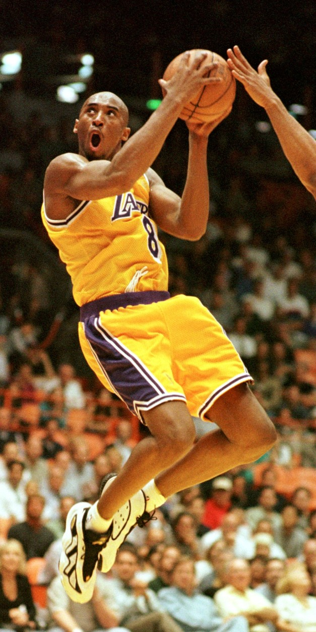 Kobe Bryant of the Los Angeles Lakers goes in for a layup against the Utah Jazz during the second half of their playoff game Thursday, May 8, 1997, in Inglewood, Calif.  The Lakers won 104-84. (AP Photo/Chris Pizzello)