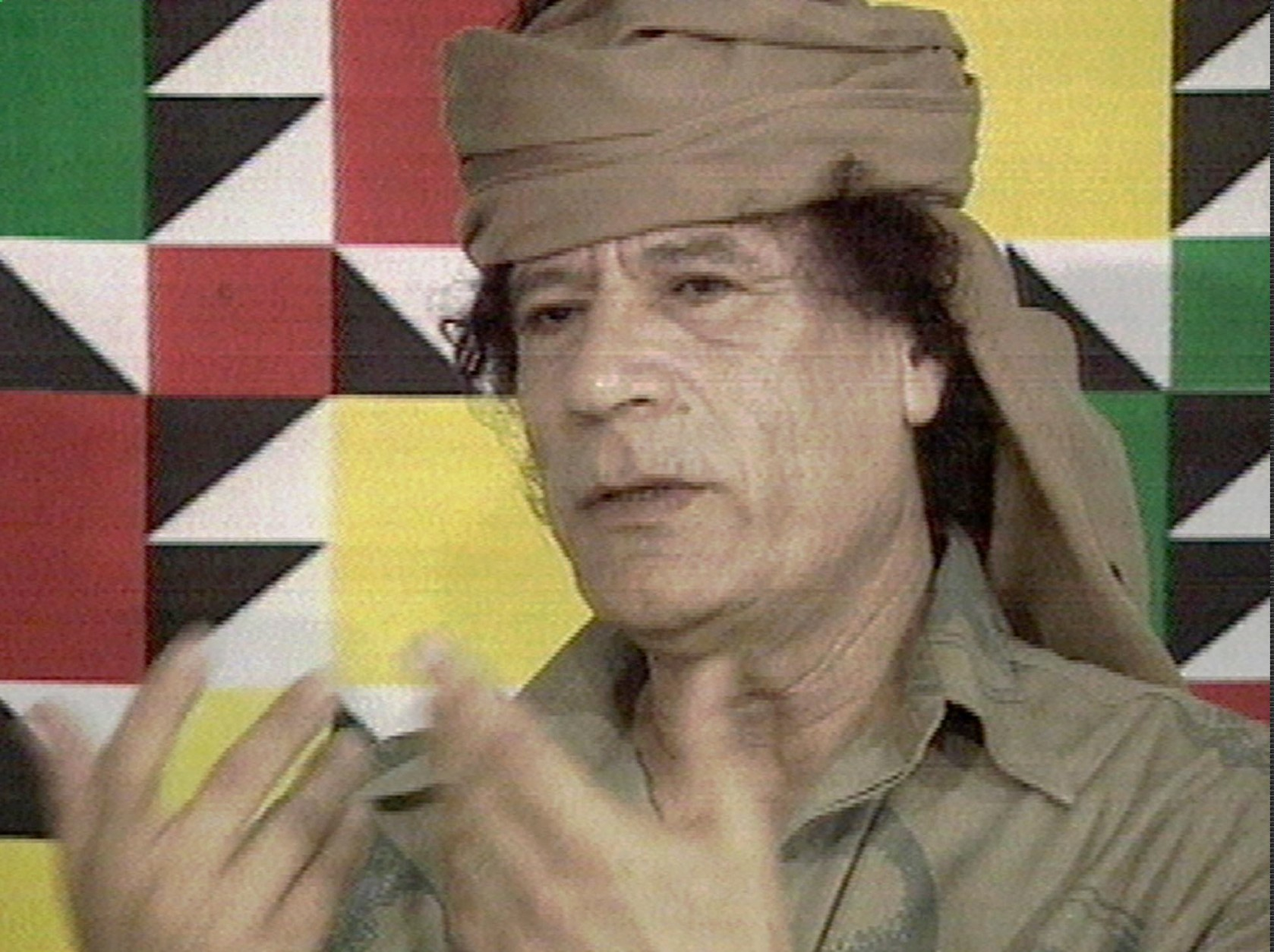 LIBYAN LEADER, DICTATOR, SPEAKING, GESTURING TURBAN,