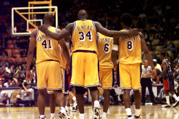 """FILE- This Feb. 5, 1999 file photo shows Los Angeles Lakers center Shaquille O'Neal (34) putting his arms around teammates, Elden Campbell (41) and Kobe Bryant (8) as Eddie Jones (6) and Derek Harper walk in front as they return to play the Houston Rockets in the fourth quarter at the Great Western Forum in Inglewood, Calif. O'Neal says on Twitter that he's """"about to retire."""" O'Neal sent a Tweet shortly before 2:45 p.m. saying, """"im retiring."""" It included a link to a 16-second video in which he says, """"We did it; 19 years, baby. Thank you very much. That's why I'm telling you first: I'm about to retire. Love you. Talk to you soon."""" (AP Photo/ Victoria Arocho,File)"""