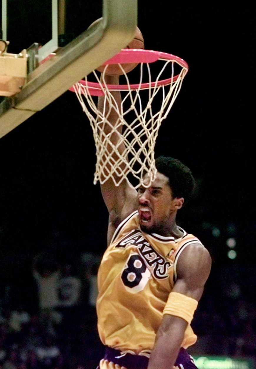 Los Angeles Lakers' Kobe Bryant slam dunks in the closing seconds  against the Phoenix Suns Wednesday, March 3, 1999, in Inglewood, Calif. The Lakers won 101-95. (AP Photo/Mark J. Terrill)
