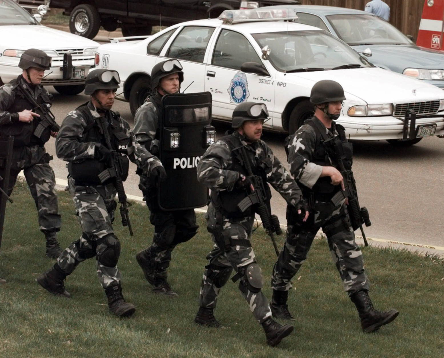 FILE - In this April 20, 1999 file photo members of a police SWAT march to Columbine High School in Littleton, Colo., as they prepare to do a final search of the school. Classes are canceled Tuesday, April 20, 2010 at Columbine High School on the anniversary of the 1999 shootings. Twelve students and a teacher died in the shootings before two teenage gunmen committed suicide. (AP Photo/Ed Andrieski, File)