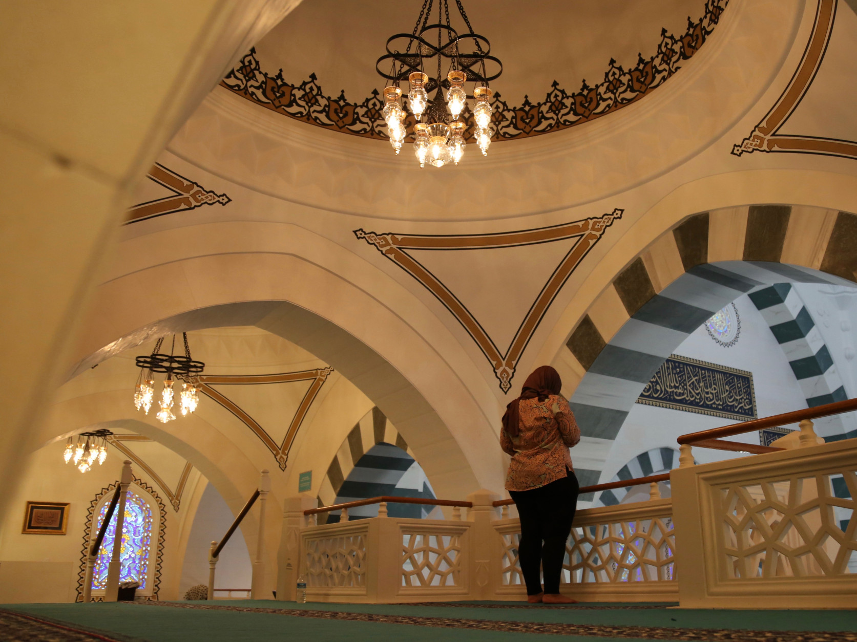 It's her first time attending the Friday prayer at the Diyanet Center of America on Friday, April 1, 2016 in Lanham, ...