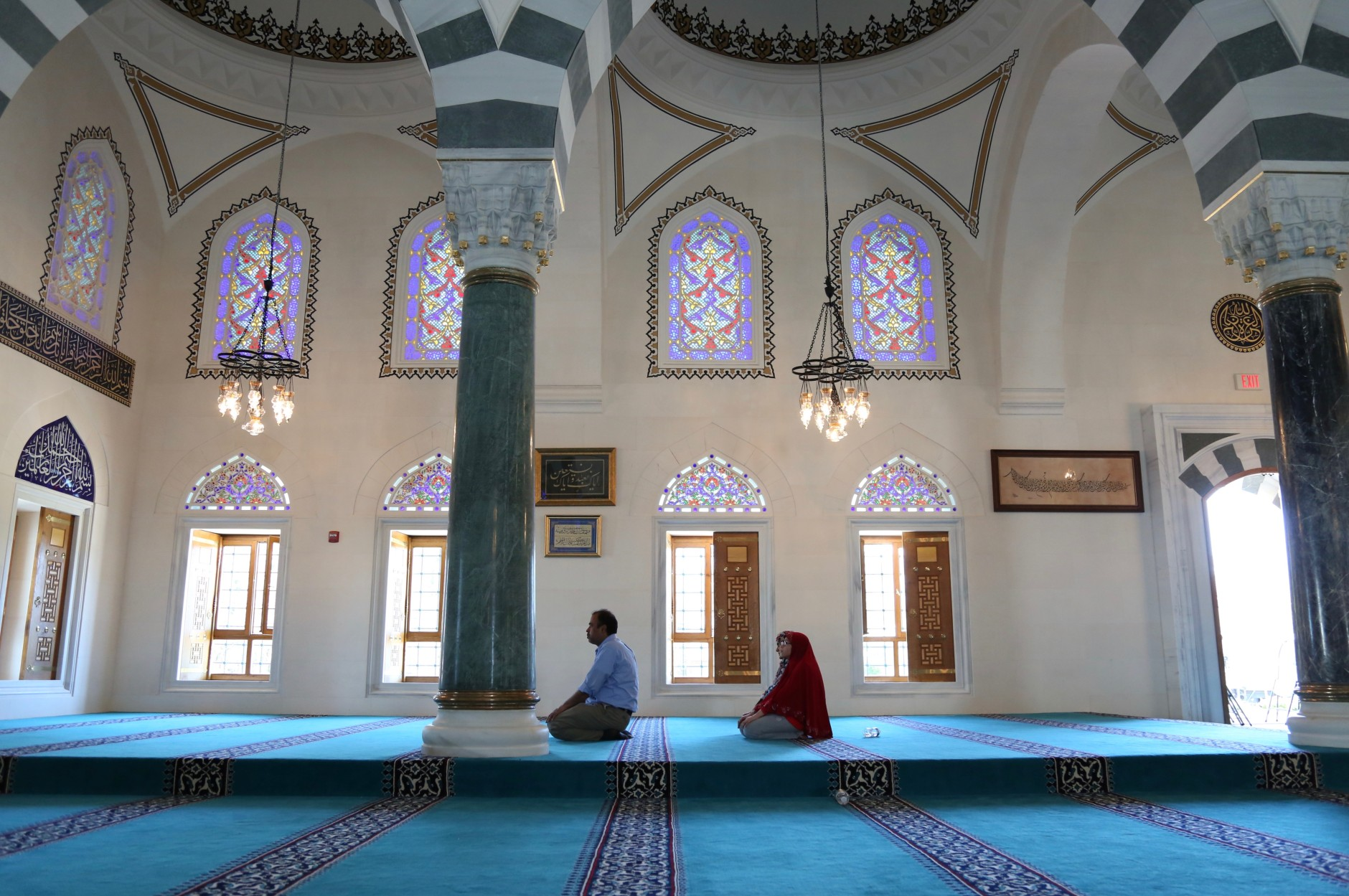 Arriving late to the Friday prayer, Kamran Shaikh and his wife Sofia and daughter Isra follow him in prayer at the Diyanet Center of America on Friday, ...