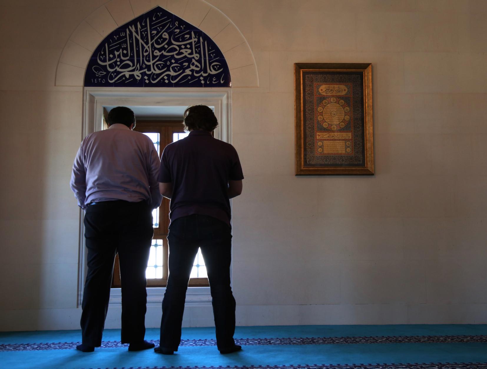 Diab Mustafa, left, and Ibrahim Issa, right, pray the Muslim afternoon prayer, Dhuhr, on Friday, April 1, 2016 at the Diyanet Center of America in Lanham, ...