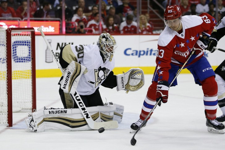 Pittsburgh Penguins goalie Matt Murray (30) deflects a shot with Washington  Capitals center Jay Beagle (83) nearby in the first period of an NHL hockey. eb92153d2d8