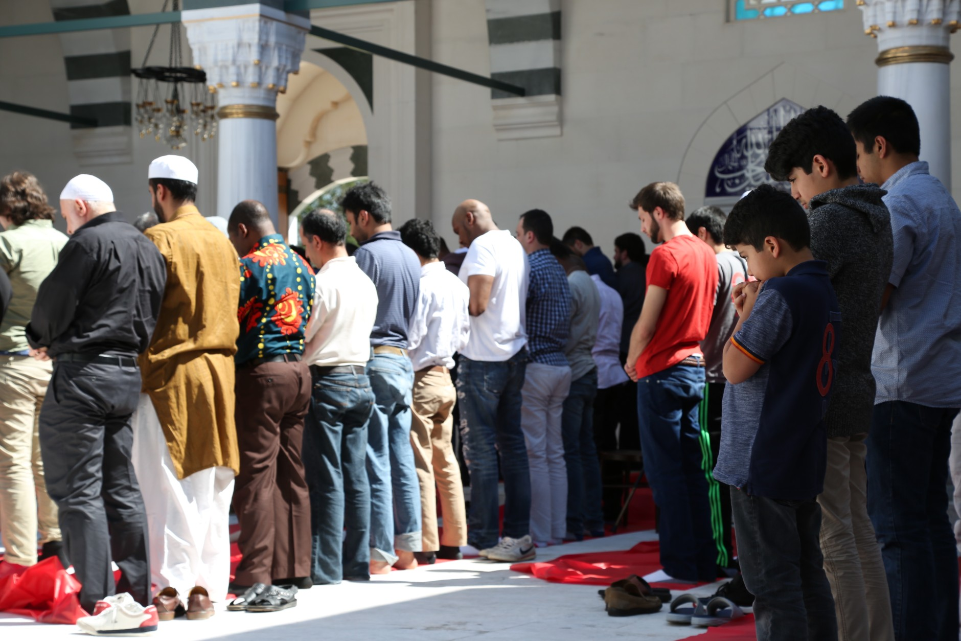 Men line up in prayer on Friday April 1, 2016 at the Diyanet Center of America's mosque in Lanham, Md. (WTOP/Omama Altaleb)