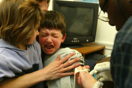 In 2004, four-year-old Nic Cappella cries as a blood sample is drawn.  (Photo by Alex Wong/Getty Images)