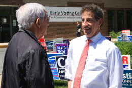 In this Wednesday, April 20, 2016 photo, State Sen. Jamie Raskin, right, who is running in the Democratic primary for Maryland's 8th Congressional District, talks to a supporter who voted early for him, in Chevy Chase, Md. (AP Photo/Brian Witte)