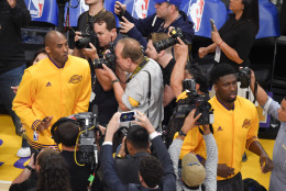 Los Angeles Lakers forward Kobe Bryant, left, takes the court for his final NBA basketball game, against the Utah Jazz, Wednesday, April 13, 2016, in Los Angeles. (AP Photo/Mark J. Terrill)