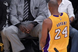 Former player Shaquille O'Neal watches as Los Angeles Lakers forward Kobe Bryant walks by during the first half of Bryant's last NBA basketball game, against the Utah Jazz, Wednesday, April 13, 2016, in Los Angeles. (AP Photo/Mark J. Terrill)