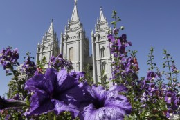 FILE - In this Sept. 3, 2014, file photo flowers bloom in front of the Salt Lake Temple, at Temple Square, in Salt Lake City. Mormon leaders aren't expected to mention presidential candidates by name at this weekend's church conference, but they may reiterate their push for more public civility and compassion. The twice-a-year conference runs Saturday and Sunday at the Salt Lake Temple. (AP Photo/Rick Bowmer, File)