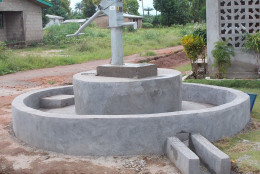 """Seth Lewis raised $6,875 to build this well in Thumorso, Sierra Leone that serves a community of 160 people. """"It's great to see pictures of people at the well drinking the water,"""" Lewis said. (Photo courtesy of TheWaterProject.org)"""