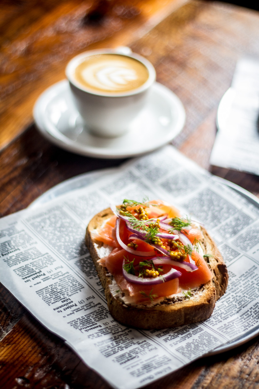 The Den's smoked salmon and dill toast is served withed whipped cream cheese, shaved red onion and pickled mustard seed on marble rye. (Photo by Farrah Skeiky)
