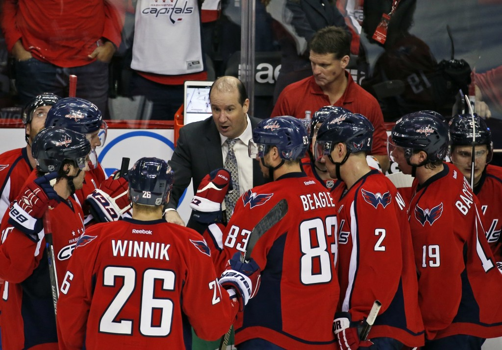 Washington Capitals assistant coach Todd Reirden talks with the team during a timeout in the third period of Game 1 in the first round of the NHL Stanley Cup hockey playoffs against the Philadelphia Flyers, Thursday, April 14, 2016, in Washington. The Capitals won 2-0. (AP Photo/Alex Brandon)