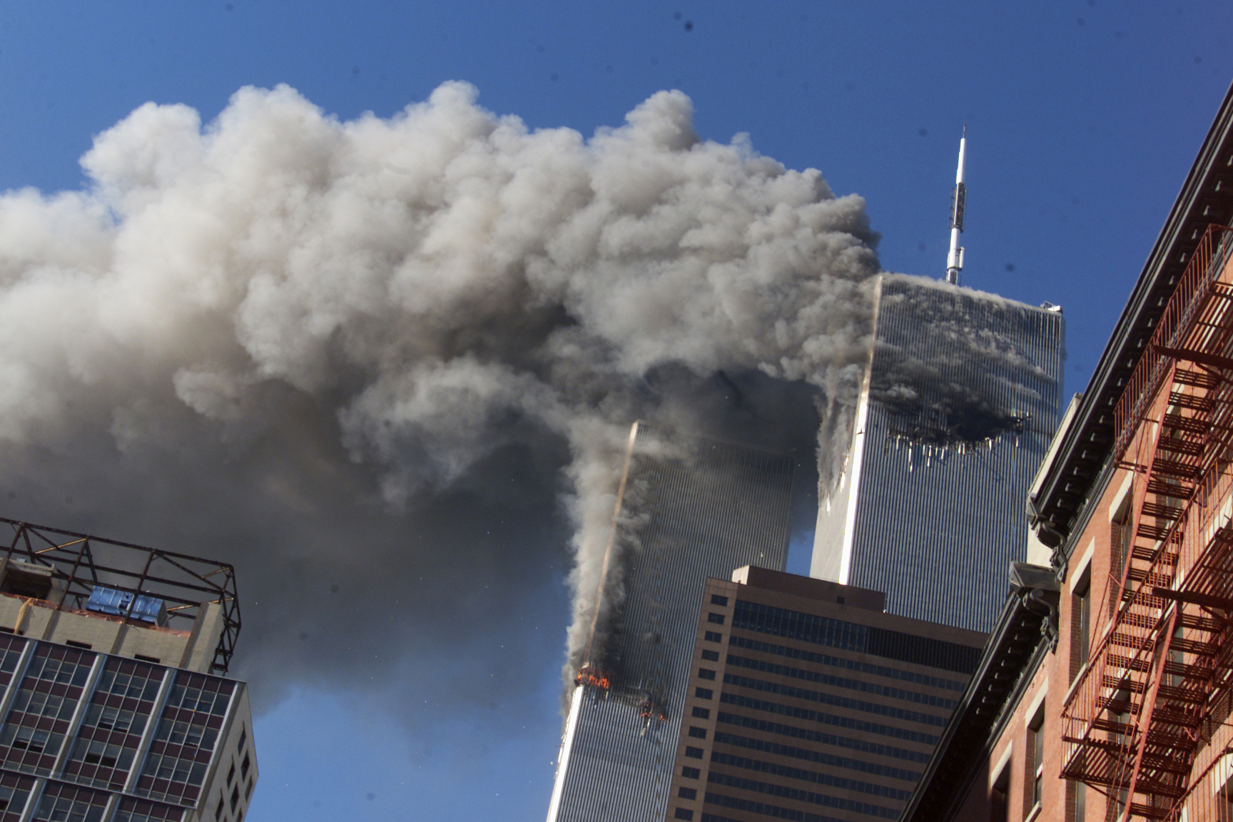 FILE - In this Sept. 11, 2001 file photo, smoke rising from the burning twin towers of the World Trade Center after hijacked planes crashed into the towers, in New York City. Every American of a certain age has a 9/11 story _ vivid memories of where they were, what they saw, how they felt on that awful day. Donald Trump is one of them. And for New Yorkers like him, 9/11 melds first-hand experience with what they felt in their guts, what they saw on television and what was playing out in the lives of friends and loved ones in a city under siege.  (AP Photo/Richard Drew, File)