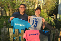 """Seth's dad offers support and advice while letting the teen take full responsibility for the projects. """"I just try to give him background on some business principals,"""" said Phil Lewis. """"He had to negotiate contracts for the shirts, [and learned] how to follow up on the website with customer service. So, when someone does a donation he tries to send back a personalized message thanking them every time,"""" Lewis said. (WTOP/Kristi King)"""