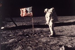 "Astronaut Edwin E. ""Buzz"" Aldrin Jr.  poses for a photograph beside the U.S. flag deployed on the moon during the Apollo 11 mission on July 20, 1969.  Aldrin and fellow astronaut Neil Armstrong were the first men to walk on the lunar surface with temperatures ranging from 243 degrees above to 279 degrees below zero.  Astronaut  Michael Collins flew the command module.  The trio was launched to the moon by a Saturn V launch vehicle at 9:32 a.m. EDT, July 16, 1969. They departed the moon July 21, 1969. (AP Photo/NASA/Neil A. Armstrong)"