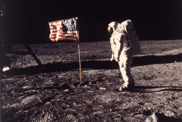 """Astronaut Edwin E. """"Buzz"""" Aldrin Jr.  poses for a photograph beside the U.S. flag deployed on the moon during the Apollo 11 mission on July 20, 1969.  Aldrin and fellow astronaut Neil Armstrong were the first men to walk on the lunar surface with temperatures ranging from 243 degrees above to 279 degrees below zero.  Astronaut  Michael Collins flew the command module.  The trio was launched to the moon by a Saturn V launch vehicle at 9:32 a.m. EDT, July 16, 1969. They departed the moon July 21, 1969. (AP Photo/NASA/Neil A. Armstrong)"""