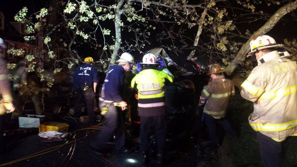 Rescuers from the College Park Fire Department work to free a person who was trapped after a tree fell onto a car in tthe 9600 block of 49th Ave. in College Park, Md. on Saturday, April 2 , 2016. (College Park Fire Department via Twitter)