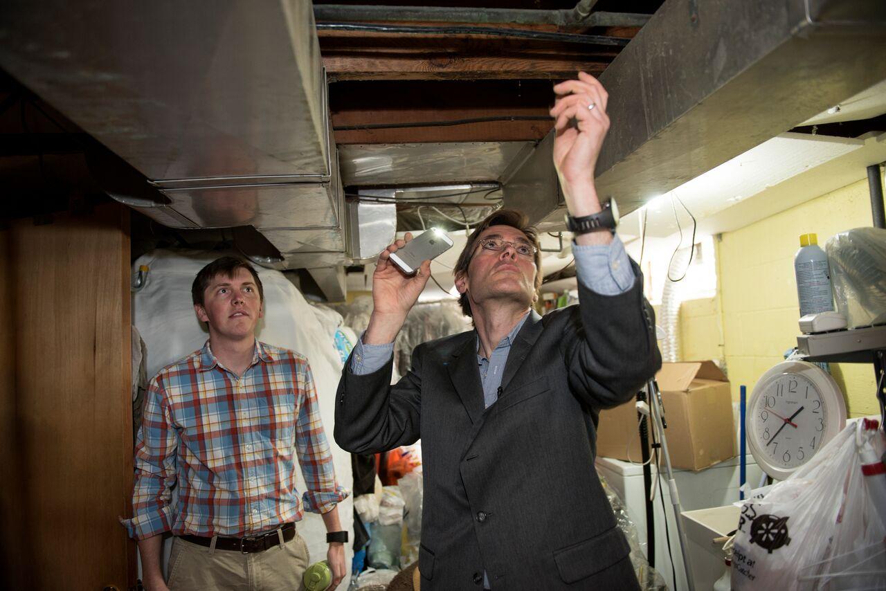 Marc Edwards examines plumbing in Flint, Michigan. (Photo courtesy Virginia Tech)