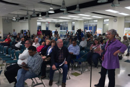Several people who attended the meeting had questions about the I-395 Express Lanes plan. Some were concerned about the price of the tolls, while others wanted to know the location and height of proposed new sound walls. (WTOP/Michelle Basch)
