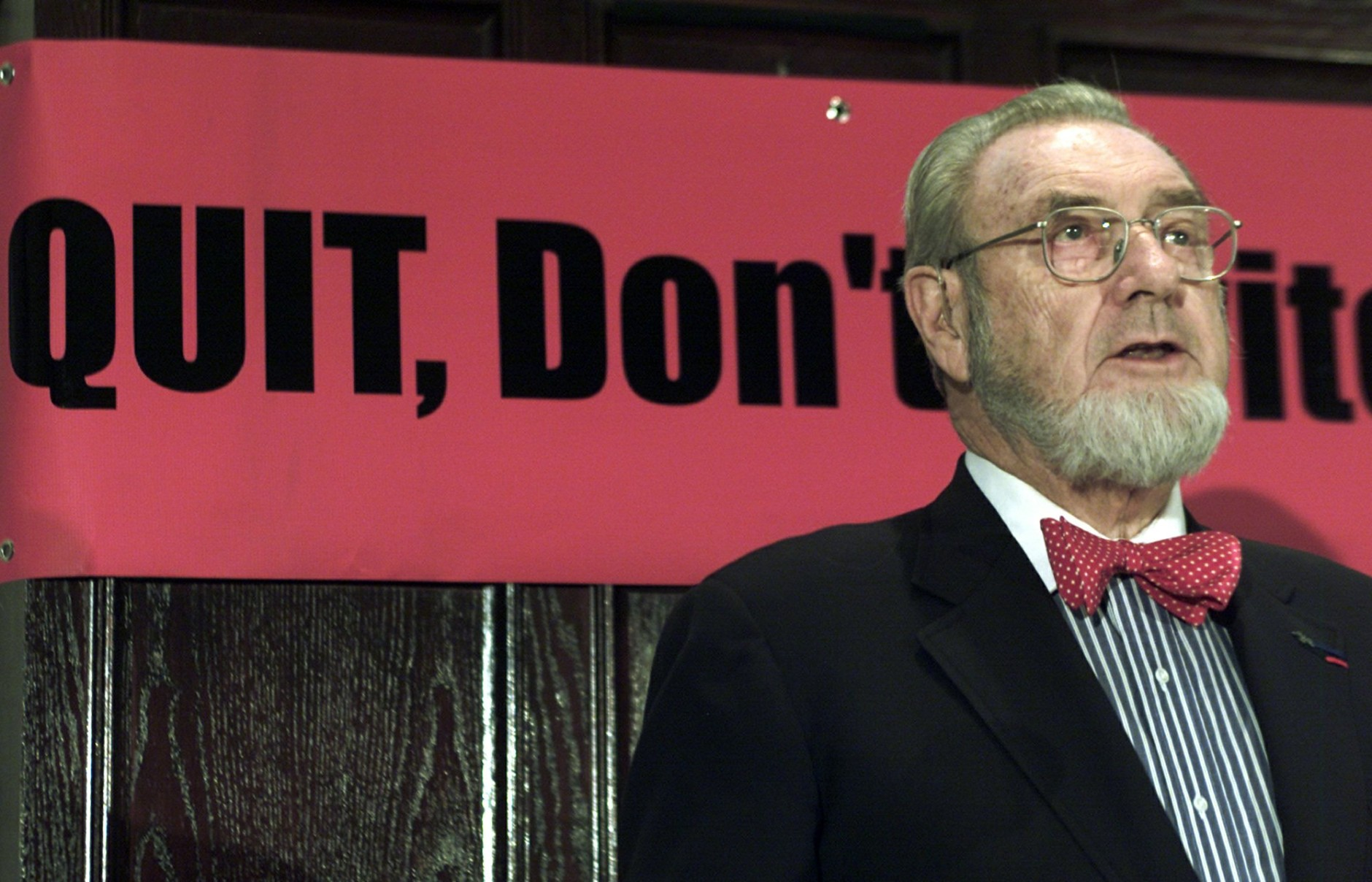 """Former Surgeon General C.Everett Koop meets reporters at the National Press Club in Washington Tuesday, Nov. 27, 2001 to discuss an National Cancer Institute report that says that people who believe they are reducing their risk of getting smoking-related diseases by using """"low-tar"""" or light cigarettes are wrong. (AP Photo/Joe Marquette)"""