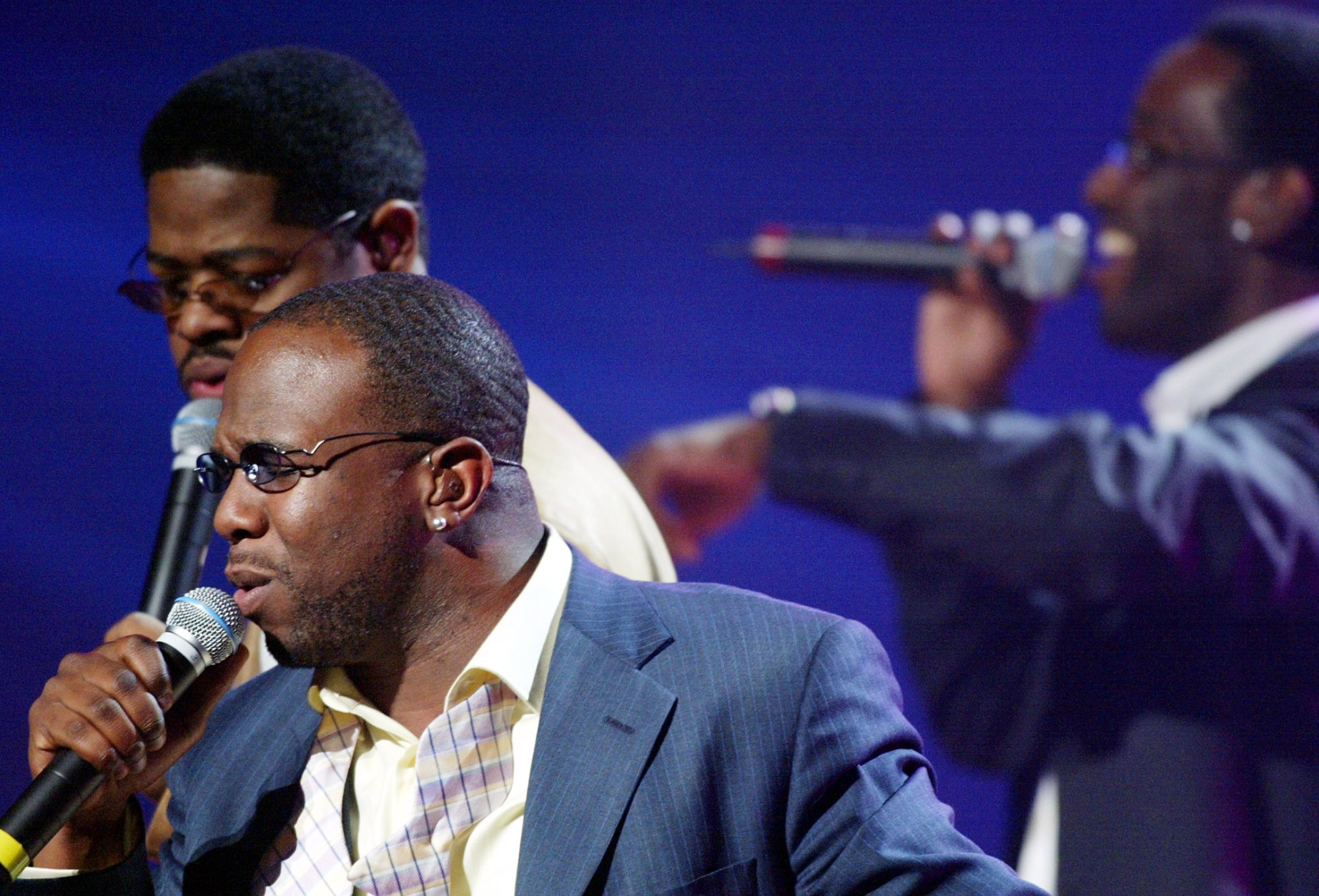 Boyz II Men, clockwise from foreground, Wanya Morris, Nathan Morris and Shawn Stockman perform during the first MTV Video Music Awards Japan in Tokyo Friday night, May 24, 2002.  Boyz II Men, Sheryl Crow, Nickelback and other American talent joined such Japanese stars as Rip Slyme and rapper Zeebra for the first MTV Music Awards Japan. (AP Photo/Shizuo Kambayashi)