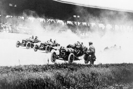 Drivers speed into the first turn on the Brickyard in the first Indianapolis 500-mile race in Indianapolis, Ind., Thursday, May 30, 1911.  The drivers from left are, Will Jones (9) driving a Case; Joe Jagersberger (8) in a Case; and Louis Disbrow (5) in a Pope-Hartford. Ray Harroun won the race at an average speed of 74.602 miles per hour.  (AP Photo)