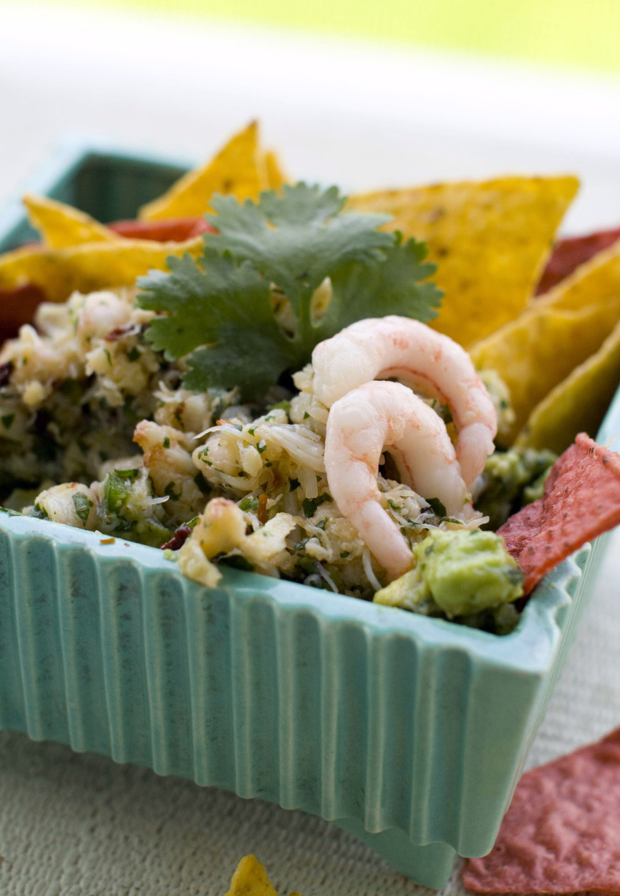 "This June 1, 2011 photo shows seafood guacamole in Concord, N.H.  This recipe from Roberto Santibanez' ""Truly Mexican,"" can be prepared and refrigerated up to an hour in advance, but let it warm at room temperature a bit before serving.  (AP Photo/Matthew Mead)"
