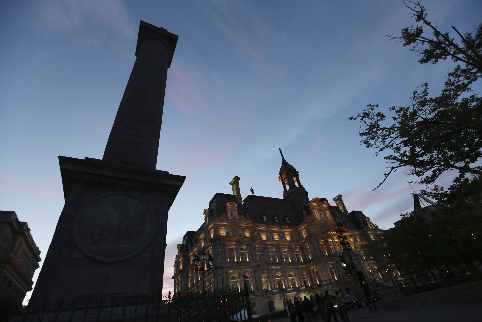 A view of Place Jacques Cartier in Montreal from the old harbor, in Montreal, Canada, Tuesday, June 4, 2013. (AP Photo/Luca Bruno)