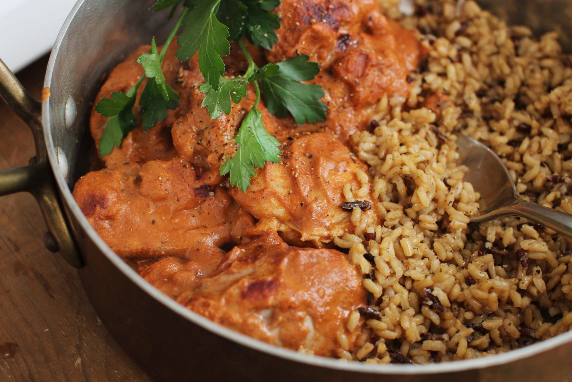 This Feb. 15, 2016 photo shows chicken mole served with a side of wild and brown rice in Concord, N.H. Mole is a style of Mexican sauces often served with meats. It usually is made from ground nuts, chocolate or cocoa and a variety of seasonings. (AP Photo/Matthew Mead)