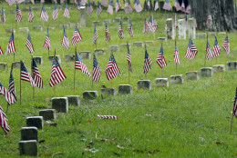 American flags decorate unmarked graves of American servicemen at the Vicksburg National Cemetery, Friday, May, 27, 2016, in Vicksburg, Miss., in advance of the Memorial Day weekend. (AP Photo/Rogelio V. Solis)