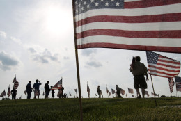 Throngs of scouts place thousands of flags on veteran's graves at Brig. Gen. William C. Doyle Veterans Memorial Cemetery in honor of Memorial Day, Friday, May 27, 2016, in Wrightstown N.J. (AP Photo/Mel Evans)