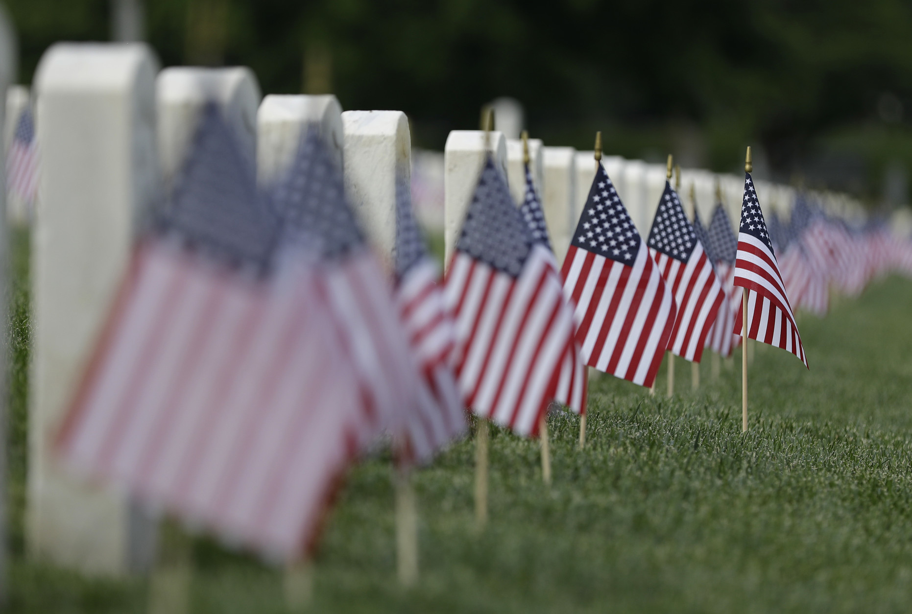 American flags fly next to veterans' graves ahead of Memorial Day at the Crown Hill National Cemetery, Saturday, May 28, 2016, in Indianapolis. (AP Photo/Darron Cummings)